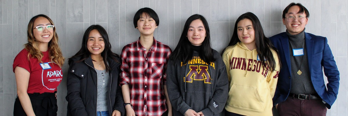 A group of six smiling Asian American college students.